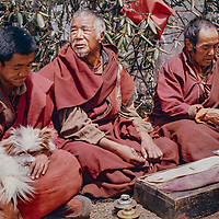 Tebetan Buddhist monks chant and blow ceremonial horns above Tengboche Monastery in the Khumbu Region of Nepal's Himalaya.