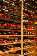 New York, NY, Sept. 30, 2013. Grant Reynolds, wine director at Charlie Bird. The dining room level wine storage.