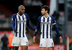 West Bromwich Albion's Allan Nyom (left) and West Bromwich Albion's Claudio Yacob (right) after the final whistle during the Premier League match at the Vitality Stadium, Bournemouth.