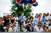 """SHOT 7/29/2007 - Zorigtbaatar Boldbaatar (top of frame), 15, of Denver leaps into the air while performing """"Mongolians on Horses"""", a musical and dance piece that describes the nomadic lifestyle of the Mongolian people. Boldbaatar was performing Mongolian dances as part of a larger demonstration of the cultures represented at the 2007 Colorado Dragon Boat Festival. The sport of Dragon boat racing is over 2000 years old and features teams of 18 paddlers - nine men and nine women plus someone to steer the boat - all rowing in sync to the beat of a drum and racing to a flag 200 meters away on Sloan's Lake in Denver, Co. Founded in 2001 to celebrate Denver?s rich Asian Pacific American culture, the Colorado Dragon Boat Festival has become the region?s fastest growing and most acclaimed new festival. Festival-goers get to explore the Asian culture through demonstrations, crafts, shopping, eating, and the growing sport of dragon boat racing. .(Photo by Marc Piscotty / © 2007)"""