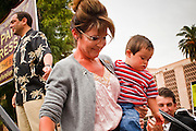 22 OCTOBER 2010 - PHOENIX, AZ:  SARAH PALIN and her son TRIG leave the stage after Sarah Palin spoke at a Tea Party rally in Phoenix, AZ, Friday. About 300 people attended a Tea Party rally on the lawn of the Arizona State Capitol in Phoenix Friday. They demanded lower taxes, less government spending, repeal of the health care reform bill, and strengthening of the US side of the US - Mexican border. They listened to Arizona politicians and applauded wildly when former Alaska Governor Sarah Palin and her son, Trig, made a surprise appearance. The event was a part of the Tea Party Express bus tour that is crossing the United States.     Photo by Jack Kurtz