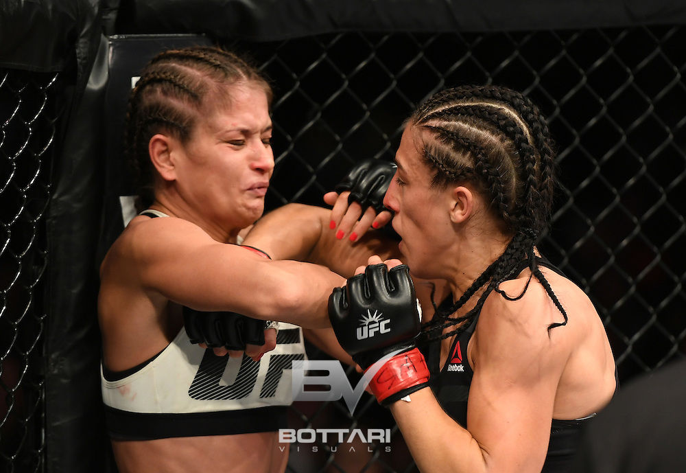 NEW YORK, NY - NOVEMBER 12:  Karolina Kowalkiewicz of Poland (left) fights against Joanna Jedrzejczyk of Poland in their women's strawweight championship bout during the UFC 205 event at Madison Square Garden on November 12, 2016 in New York City.  (Photo by Jeff Bottari/Zuffa LLC/Zuffa LLC via Getty Images)