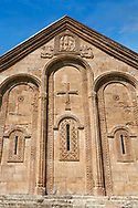Pictures & images of Nikortsminda ( Nicortsminda ) St Nicholas Georgian Orthodox Cathedral exterior and its Georgian relief sculpture stonework, 11th century, Nikortsminda, Racha region of Georgia (country). A UNESCO World Heritage Tentative Site. .<br /> <br /> Visit our MEDIEVAL PHOTO COLLECTIONS for more   photos  to download or buy as prints https://funkystock.photoshelter.com/gallery-collection/Medieval-Middle-Ages-Historic-Places-Arcaeological-Sites-Pictures-Images-of/C0000B5ZA54_WD0s<br /> <br /> Visit our REPUBLIC of GEORGIA HISTORIC PLACES PHOTO COLLECTIONS for more photos to browse, download or buy as wall art prints https://funkystock.photoshelter.com/gallery-collection/Pictures-Images-of-Georgia-Country-Historic-Landmark-Places-Museum-Antiquities/C0000c1oD9eVkh9c