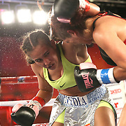 Noemi Bosques (R) andt Nydia Feliciano square off during a Telemundo Boxeo boxing match at the A La Carte Pavilion on Friday,  March 13, 2015 in Tampa, Florida.  Feliciano won the bout by split decision. (AP Photo/Alex Menendez)