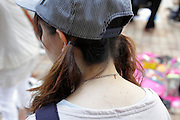 young girl with two side pony tales and cap