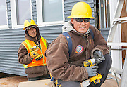 Construction workers at work on a new energy efficient test home, Quinhagak, Alaska, Model Released, Isaac J.B. Sam and Timothy Kelly Jr.