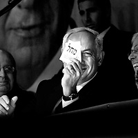 Benjamin Netanyahu hold a Likud's election note during a conference in Haifa, February 2009.