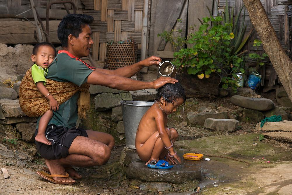 Chang Naga bathing<br /> Chang Naga headhunting Tribe<br /> Tuensang district<br /> Nagaland,  ne India