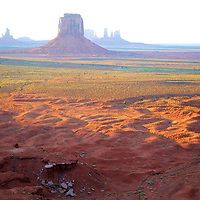 Warm sunset upon the surprisingly verdant desert valley in front of the Right Mitten Mesa in the timeless Monument Valley Navajo Tribal Park (Arizona/Utah/Navajo Nation).