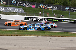 July 22, 2018 - Loudon, NH, U.S. - LOUDON, NH - JULY 22: (19) Daniel Suarez leads (42) Kyle Larson, (17) Ricky Stenhouse Jr., and (21) Paul Menard through turn 3 during the Monster Energy Cup Series Foxwoods Resort Casino 301 race on July, 21, 2018, at New Hampshire Motor Speedway in Loudon, NH. (Photo by Malcolm Hope/Icon Sportswire) (Credit Image: © Malcolm Hope/Icon SMI via ZUMA Press)