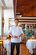 The Kahala Resort and Hotel, located in Honolulu on the souths side of Diamond Head, offers luxurious accommodations and is the only hotel in Oahu with a dolphin program. Chef Thomas Ho of Hoku's restaurant.
