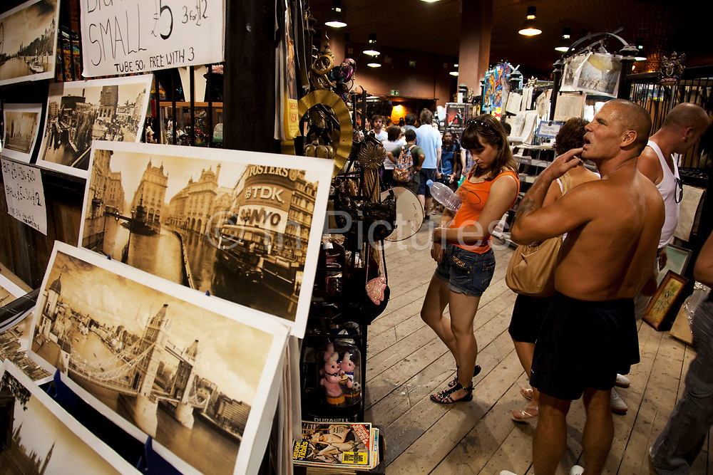 Old photographs for sale at Camden Market, North London. Camden Lock is a crowded hang out for young Londoners.