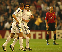Photo. Javier Garcia<br />08/04/2003 Real Madrid v Man Utd, UEFA Champions League Quarter-Final first leg, Estadio Santiago Bernabeu<br />With a stunned Rio Ferdinand in the background, Luis Figo and Ronaldo discuss Figo's opener