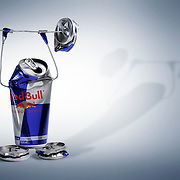 A creative product shots showing a Red Bull energy drink product lifting weights. Photographed by Stuart Freeman in the Hype photography studio.