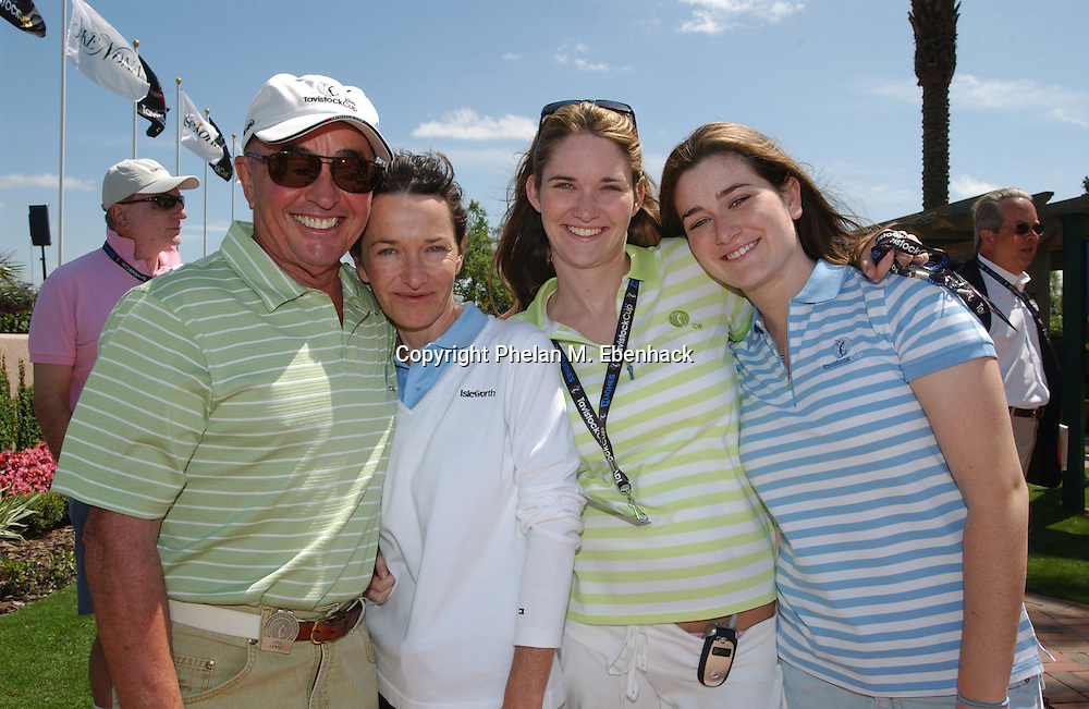 British billionaire Joe Lewis, from left, daughter Vivienne Lewis, and her two daughters Joanna Silverton and Alexandra Silverton pose for a photo during the Tavistock Cup golf tournament at the exclusive Isleworth community in Orlando, Florida, Feb. 28, 2005.  Lewis recently lost more than $1 Billion when the stock of Bear Stearns collapsed.