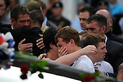 Mourners weep as the repatriation cortege carrying British servicemen is driven through the town of Wootton Bassett in western England, June 29, 2010. Pic: Paul Hackett