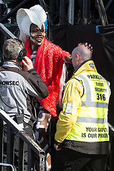© Licensed to London News Pictures . 07/06/2015 . Manchester , UK . GRACE JONES thanks the security guard who has carried her on his shoulders during her performance on the main stage at The Parklife 2015 music festival in Heaton Park , Manchester . Photo credit : Joel Goodman/LNP