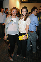 Left to right, NATASHA CORRETT and KELLY EASTWOOD at the launch of 'Glenmorangie 5 Senses' an exhibition of photographs by Mike Figgis held at Proud Camden, Stables Market, London NW1 on 13th May 2008.<br />