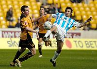Photo: Ed Godden.<br />Wolverhampton Wanderers v Brighton & Hove Albion. Coca Cola Championship. 22/04/2006. Mark Davis (L) and Brighton's Alexis Nicolas (R).