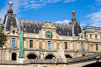 Paris, France. View from a boat on the river Seine. The Louvre is one of the world's largest museums.