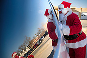 """05 DECEMBER 2020 - INDIANOLA, IOWA: STAN THOMPSON, dressed as Santa Claus, talks to children in their car during a drive through visit with Santa Claus. This is the seventh year the Thompsons have dressed as the Clauses to entertain the children of Indianola. About 500 children visited Santa Claus and Mrs. Claus in Indianola Saturday. The town has hosted Santa on the town square for the last seven years but the COVID-19 (SARS-Cov-2) pandemic forced organizers to move the event to the parking lot of a local hardware store and do it """"drive through"""" style. Iowa has one of the highest Coronavirus test rates in the United States.        PHOTO BY JACK KURTZ"""