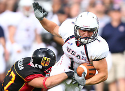 10.07.2011, Tivoli Stadion, Innsbruck, AUT, American Football WM 2011, Group A, Germany (GER) vs United States of America (USA), im Bild Oliver Radke (Germany, #27, DB) stops Nate Kmic (USA, #1, RB)  // during the American Football World Championship 2011 Group A game, Germany vs USA, at Tivoli Stadion, Innsbruck, 2011-07-10, EXPA Pictures © 2011, PhotoCredit: EXPA/ T. Haumer