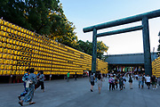 A large torii gate and lanterns at the Mitama matsuri at the controversial Yasukuni Shrine in Kudanshita, Tokyo, Japan. Friday July 14th 2017. The Mitama Matsuri is one of Japan's largest Obon festivals with over 300,000 visiting the shrine to pay respect to ancestors during the 4 days it lasts. Obon is festival of remembrance for ancestors who are believed to come back from the other world and visit the living at this time. Yasukuni Shrine, which houses the spirits of the Japanese war dead, celebrates these spirits with 30,00 yellow lanterns and mikoshi parades and traditional dancing. The festivals runs from July 13th to 16th.