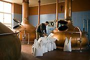 Mechelen, Belgium, ap 06, 2007, Brewery  and Hotel Carolus - Het Anker, Paul Verbruggen checking a beerbrewing proces. PHOTO©Christophe Vander Eecken