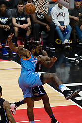 March 10, 2018 - Los Angeles, CA, U.S. - LOS ANGELES, CA - MARCH 10: Orlando Magic center Bismack Biyombo (11) grabs on to LA Clippers center DeAndre Jordan (6) and drags him down as he goes to the basket during the game between the Orlando Magic and the LA Clippers on March 10, 2018, at STAPLES Center in Los Angeles, CA. (Photo by David Dennis/Icon Sportswire) (Credit Image: © David Dennis/Icon SMI via ZUMA Press)
