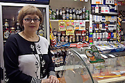 St Petersburg, Russia, 01/06/2005..Peter Dussmann, CEO of the Dussmann Group, visits Russia in connection with contracts his company have signed to upgrade and maintain the city's cleaning and related services. Valentine Vnuchkova, whose shop is in Dussmann administered property.