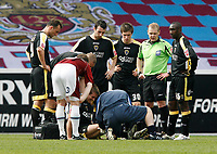 Photo: Paul Greenwood/Richard Lane Photography. <br />Burnley v Cardiff City. Coca-Cola Championship. 26/04/2008. <br />Cardiff players crowd around as physio Sean Connolly treats the injured Stephen McPhail (floor)