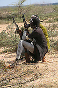 Hamar tribesmen. with AK-47 rifles Photographed in the Omo River Valley, Ethiopia