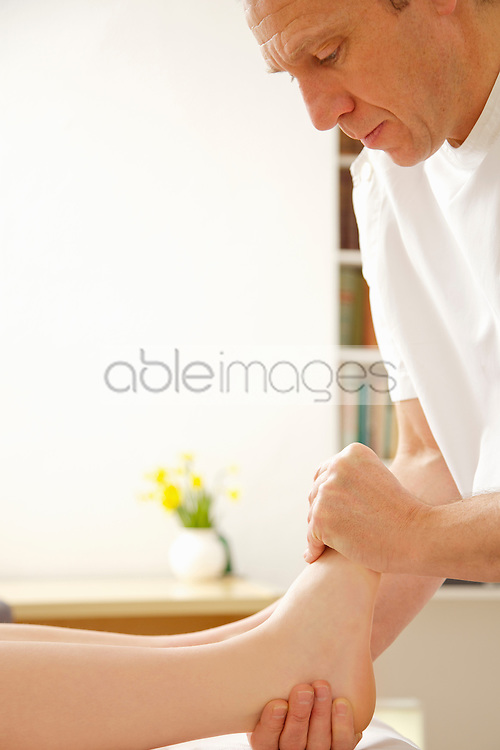 Osteopath Treating Woman's Foot