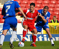 Photo: Ed Godden.<br />Swindon Town v Stockport County. Coca Cola League 2. 26/08/2006. Lee Owen (C) is challenged by Stockport's Gareth Owen (R).