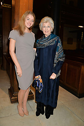 FLORA OGILVY and her grandmother PRINCESS ALEXANDRA at a reception and debate to celebrate the publication of  'Women in Waiting, Prejudice at the the Heart of the Church' by Julia Ogilvy held at St.James's Church, 197 Piccadilly, London on 11th March 2014.