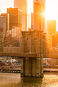 View of the Brooklyn Bridge at Sunset with the Manhattan Financial District, New York City.