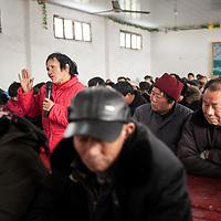 A parishioner testifies during a service at a Three-Self Church.