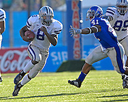 Kansas State running back James Johnson (8) rushes up field past Kansas linebacker Arist Wright (41) at Memorial Stadium in Lawrence, Kansas, November 18, 2006.  Kansas beat K-State 39-20.<br />
