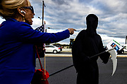 A supporter of US President Donald Trump confronts a man dressed as Death that was walking past other supporters with a Missing Person flier that had the Presidents photograph on it outside of Walter Reed National Military Medical Center as they wait for President Donald Trump to leave in Marine One after undergoing treatment for the coronavirus in Bethesda, Maryland, USA, 5 October 2020.