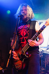 © Licensed to London News Pictures. 12/04/2014. Tilburg, Netherlands.   Hark performing live at Roadburn Festival.  In this picture - Jimbob Isaac.  Roadburn is an annual heavy rock/metal festival held in Tilburg, Netherlands.  Hark are a welsh heavy rock band composed of members Jimbob Isaac (guitar/vocals),Nikolai Ribnikov (Bass)<br /> Simon Bonwick (Drums).  Hark launched their debut album Crystalline on 10 April 2014, recorded in the Monnow Valley Studios where Oasis and Led Zepellin also recorded their debut albums.  Photo credit : Richard Isaac/LNP