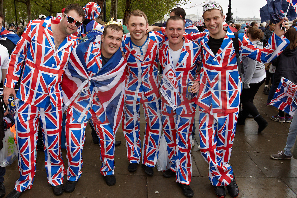 © Licensed to London News Pictures. 03/06/2012. LONDON, UK. Five men in union jack fancy dress suits get ready to watch the flotilla of one thousand ships go past. The Royal Jubilee celebrations. Great Britain is celebrating the 60th  anniversary of the countries Monarch HRH Queen Elizabeth II accession to the throne this weekend Photo credit : Cliff Hide/ LNP