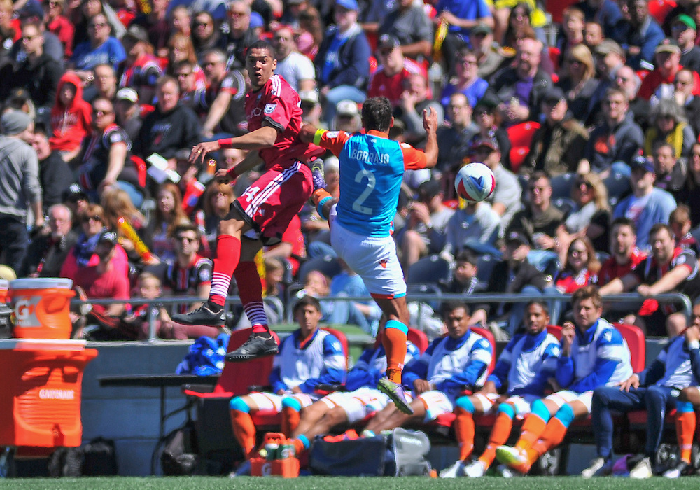 Ottawa Fury FC defender Onua Obasi (#14) beats Miami FC defender Jonathan Borrajo (#2) in the air during the NASL match between the Ottawa Fury FC and Miami FC at TD Place Stadium in Ottawa, ON. Canada on April 30, 2016. The Fury claiming their first win of the season with a 2-0 victory thanks to goals from Fernando Timbo and Dennis Chin.<br /> <br /> PHOTO: Steve Kingsman/Freestyle Photography