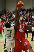 BJ Anthony drives to the net as Jets Chris Hagan tires to stop him during their NBL Game at Hamilton,,Basketball,Pistons Vs Jets, Wednesday 22 June 2011.<br /> Photo: Dion Mellow / photosport.co.nz