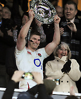 Rugby Union - 2020 Guinness Six Nations Championship - England vs. Wales<br /> <br /> England captain, Owen Farrell collects the Triple crown shield, at Twickenham.<br /> <br /> COLORSPORT/ANDREW COWIE
