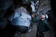 Ben Kuntz inspects a route in Deep Creek Canyon, a climbing area in Riverside State Park near Spokane, Washington.