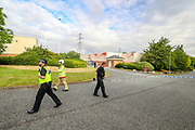 Liverpool, United Kingdom, June 10, 2021: Police and a fire rescue crew arrived at the scene in Pembroke Court, Runcorn on Thursday, June 10, 2021, after the Palestine Action activist group have scaled the roof and seized control of the landing gear factory of APPH in Liverpool. (Photo by Vudi Xhymshiti)