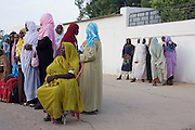 Ladies attending the first-ever international Conference on Womens' Challenge in Darfur, gather to hear speeches and traditional songs outside the compound walls belonging to the Govenor of North Darfur in Al Fasher (also spelled, Al-Fashir) where the women from remote parts of Sudan gathered to discuss peace and political issues and celebrate Darfurian culture.