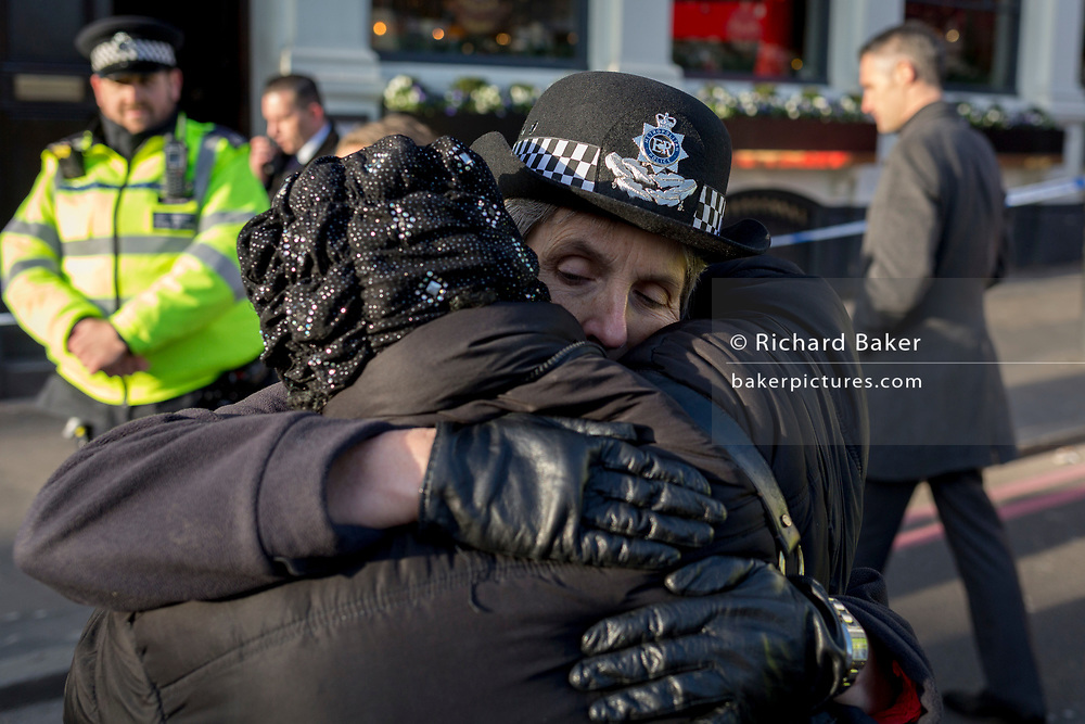 The morning after the terrorist attack at Fishmongers Hall on London Bridge, in which Usman Khan (a convicted, freed terrorist) killed 2 during a knife a attack, then subsequently tackled by passers-by and shot by armed police - Met Police Commissioner Cressida Dick hugs a local lady before touring Borough Market, on 30th November 2019, in London, England.