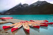 Canoes await paddlers on Lake Louise, Banff National Park, Alberta, Canada