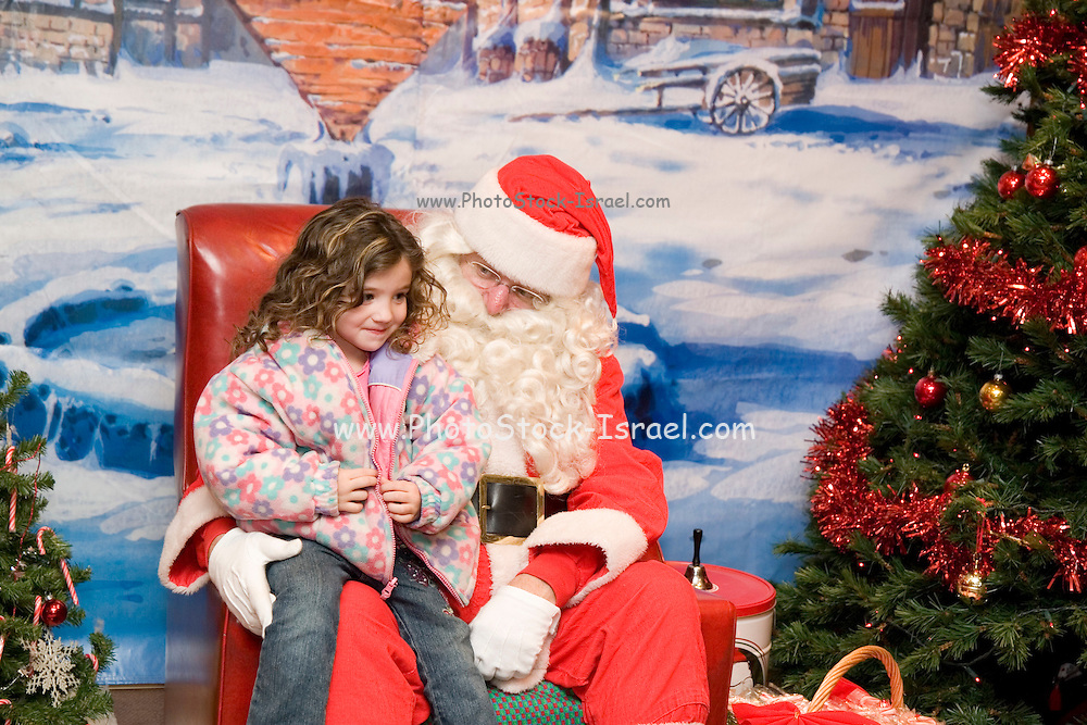 """Iowa USA, IA. Sioux City, Santa's house at the """"Festival of Trees"""" ? A charity event in which people sell their self-decorated Christmas trees and the profits go to charity. Child sitting on Santa's lap, November 2006"""